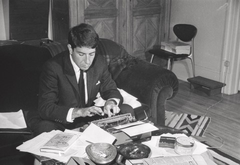Leonard Cohen at his typewriter(October 26), 1963