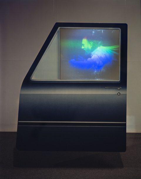 Driven II, 1985, Michael Snow, Hologramme par transmission et photographie couleur sur panneau de bois peint, lumière blanche.