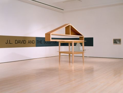 Sometimes Called Monument, 1988-1989, Wood, glass, pliers and strip painted on the wall.