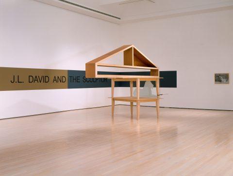 Sometimes Called Monument, 1988 - 1989, Trevor Gould, Bois, verre, pinces et bande peinte au mur.