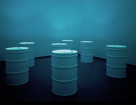 The Sleepers, 1992, 7 metal barrels, 7 black and white video monitors, 7 single-channel videos, 385 gallons of water, 1/2.