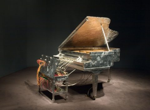 Battements et Papillons, 2006, Piano, bench, aluminum insulating tape, solenoids, motion detectors, relays, microcontrollers, transformers, miscellaneous objects.