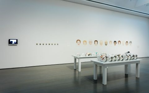 Tous ces visages, 2007-2008, Drawings (coloured pencil, felt pen and dry pastel on paper), masks (coloured pencil, felt pen, watercolour, paper, aluminum tape), polaroid photographs, video, sound, text and presentation tables.