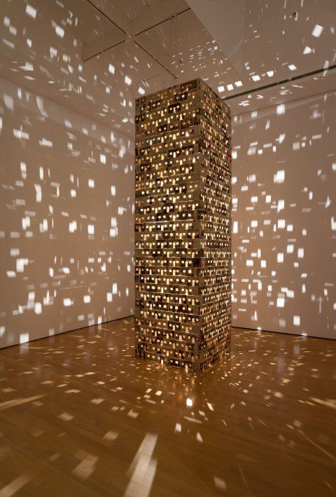 Village, 2003 - 2004, Dominique Blain, Carton, papier journal, bois et ampoules halogène.